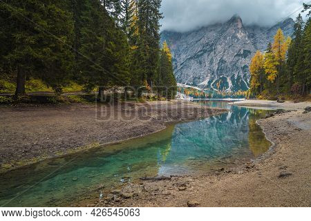 Wonderful Autumn Scenery With Turquoise Alpine Lake In The Pine Forest. Lake Braies And Spectacular