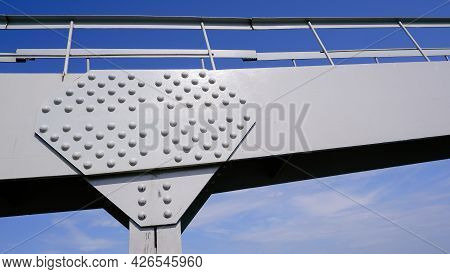 Connecting Metal Structures With Rivets. Riveted Part Of The Steel Bridge.