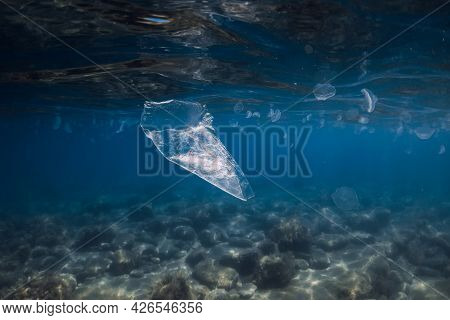 Underwater View In Sea With Plastic Bag And Rubbish, Ecological Problem