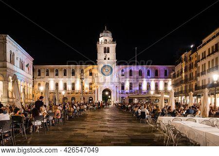 Padua, Italy - August 15 2020: Ferragosto Celebration On Piazza Dei Signori At Night With Torre Dell