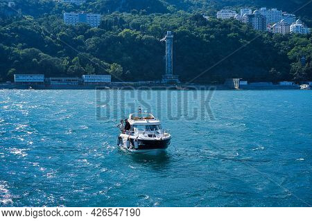 Yalta, Crimea-june 11, 2021: Seascape With A View Of A Boat With Fishermen On The Background Of The