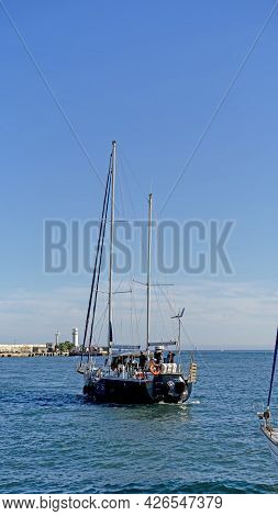 Yalta, Crimea-june 12, 2021: Seascape With A View Of The Yacht And People On The Background Of The P