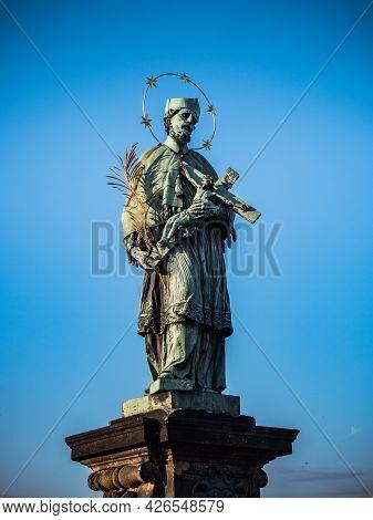 Bronze Statue Of Saint John Of Nepomuk Or Jan Nepomucky On Charles Bridge In Prague, Czech Republic