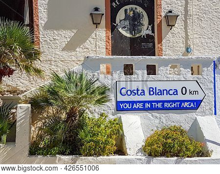 Calpe, Alicante, Spain - August 24 2016; Humorous Sign Advising Distance Of ) To Costa Blanca In Coa
