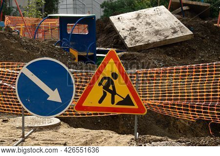 Road Works Sign And Fencing. Repair Of The Road And Playground.