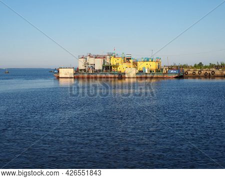 Petrozavodsk, Russia, July 10 2021 River station or seaport. Warehouses and production facilities. P