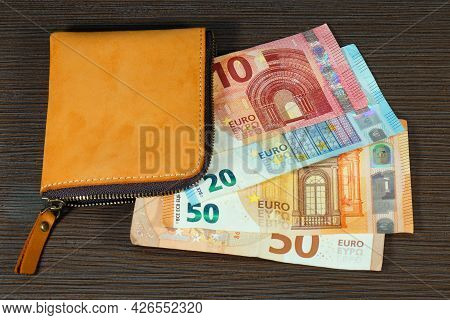 Brown Leather Wallet With Euro Currency Paper Money Bank Notes