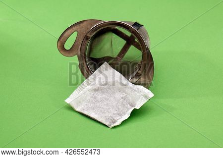 Tea Bag Packet Inside Metal Strainer Ready For Infusion In Cup