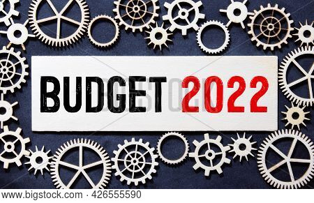 Budget 2022, Text On White Paper In A White Frame On A Gray Background Near The Office.