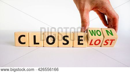 Close Won Or Lost Symbol. Businessman Turns Wooden Cubes And Changes Words Close Won To Close Lost.