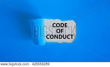 Code Of Conduct Symbol. Words 'code Of Conduct' Appearing Behind Torn Blue Paper. Beautiful Blue Bac