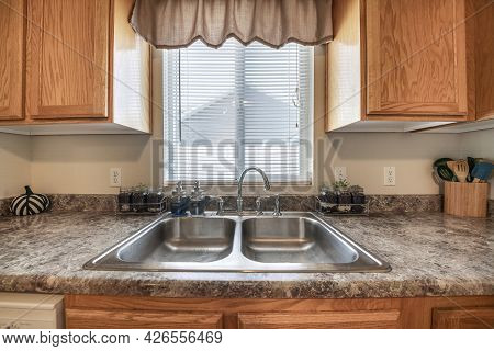 Craftsman Style Kitchen Vanity Sink With Wood Cabinets