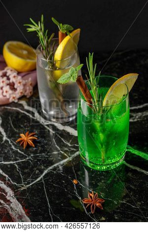 Mojito Or Tarragon In A Steamed Glass, Decorated With Lemon, Mint And Rosemary. Homemade Lemonade, R