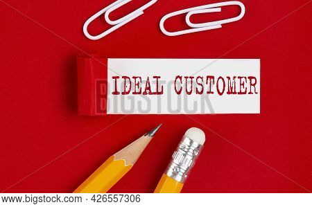Ideal Customer Written On Torn Red Paper With Pencils And Clips, Business Concept