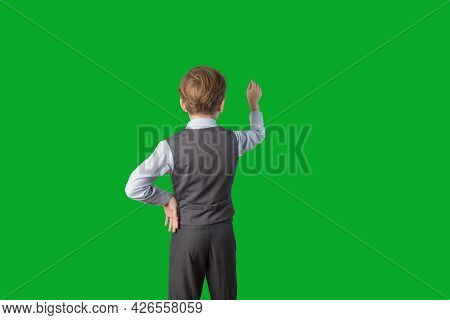 A Caucasian Boy In A School Uniform Stands With His Back To The Camera, Facing The Back Background,