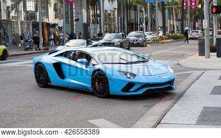 Los Angeles, California Usa - April 14, 2021: Blue Lamborghini Aventador Luxury Supercar Side View.