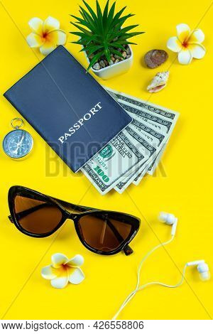 Flatlay Accessories For Summer Vacation. Travel Planning. Passport, Money, Sun Glasses On A Yellow B