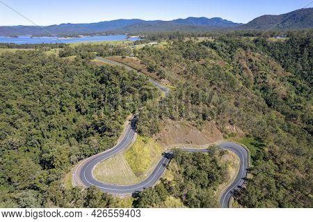 Drone Aerial Over Winding Road Traveling Towards Teemburra Dam, Queensland, Australia