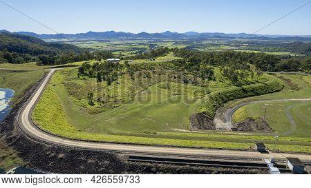 Aerial Over Rock Wall Of Teemburra Dam Queensland Australia Toward Agricultural Landscape