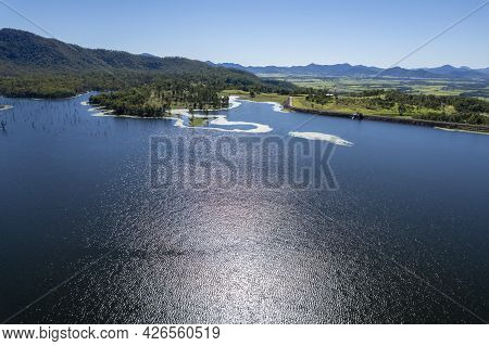 Aerial Towards Shore Over Water Captured In Bright Sunlight At Teemburra Dam Queensland Australia