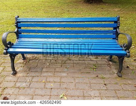 A Blue Wooden Bench In Close-up. Park Bench For Recreation