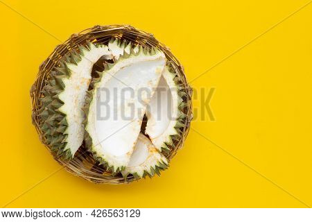 Durian Peel In Bamboo Basket On Green Background. Top View