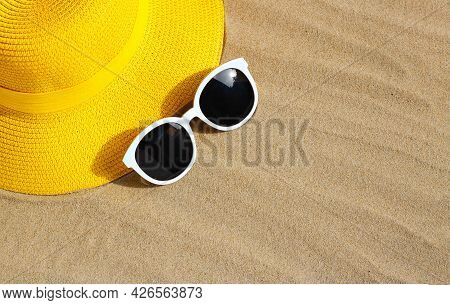 Yellow Summer Hat With Sunglasses On Sand