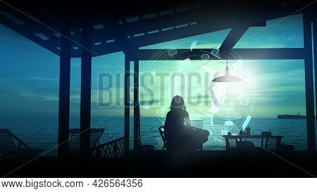 A Traveler In Her Hut Works At A Laptop After Sunset.