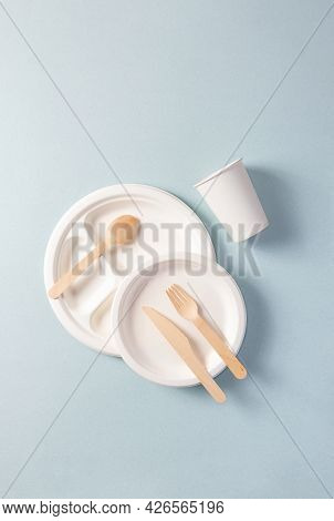 Plastic-free Disposable Tableware, Vertical. Paper Plate, Food Containers, Glass, Wooden Spoon, Fork