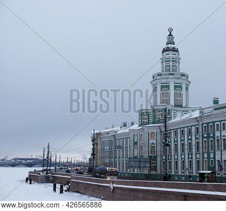View of the Kunstkamera on the University Embankment across the Neva river in Saint-Petersburg, Russia.
