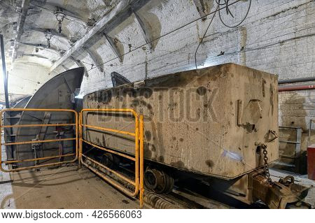 Wagon With Ore In The Tipper Room. Rotating Unloader Of Railway Underground Cars Wagon Dumper