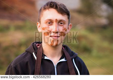 Joyful Portrait Of Man Potter With Clay Dirty Face. Young Handsome Man On Pottery Workshop Of Cerami