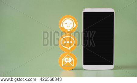 White Contact Symbol On Yellow Circle Paper And Mobile Phone, Clipping Path On Touchscreen, Contact