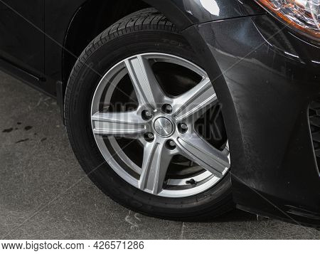 Novosibirsk, Russia - June 29, 2021:  Mazda 3, Car Wheel With Alloy Wheel And New Rubber On A Car Cl