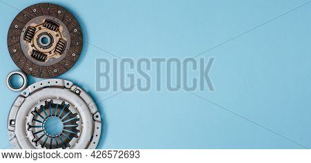 Automotive Clutch Mechanism, Disc, Basket And Bearing For Auto On A Blue Background. Car Parts. Copy