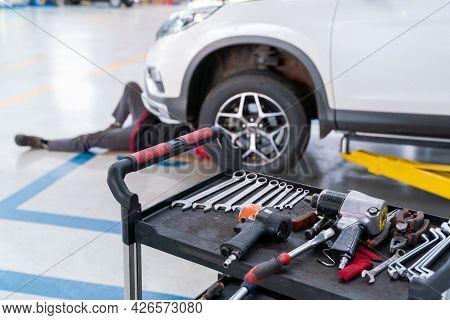 Select Focus Equipment Of Car Mechanic Adjusting Tension In Vehicle Suspension Element At Auto Repai