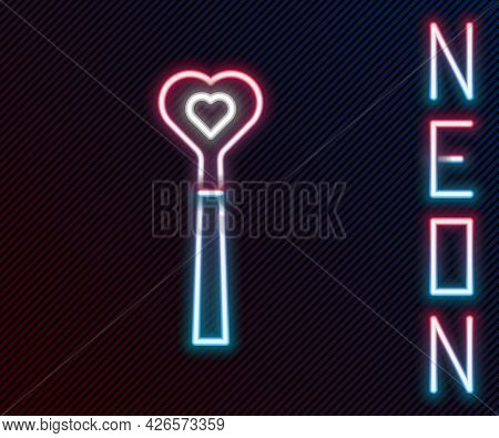Glowing Neon Line Magic Wand Icon Isolated On Black Background. Star Shape Magic Accessory. Magical