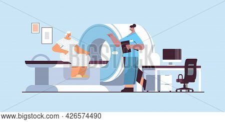 Doctor With Senior Patient In Tomography Machine Magnetic Resonance Imaging Mri Equipment Hospital R