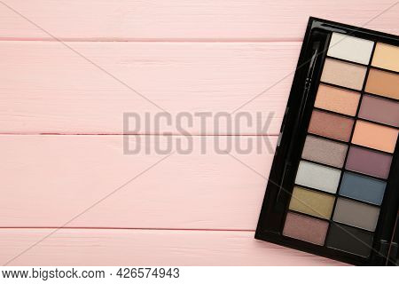 Palette Of Eyeshadows, Matte And Shimmer Eyeshadows On A Pink Background With Copy Space. Top View