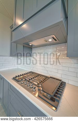 Close Up Of Cooktop Stove Under Exhaust Hood Inside Residential Home Kitchen