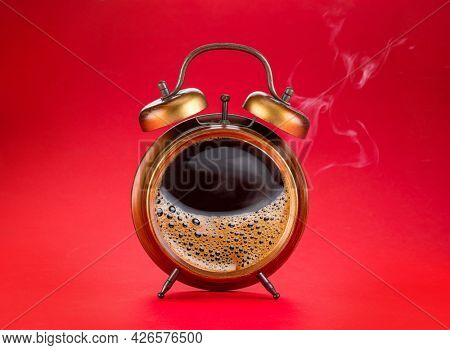 Steamy coffee drink collage. Hot coffee inside of a'larm clock as a symbol coffee time.
