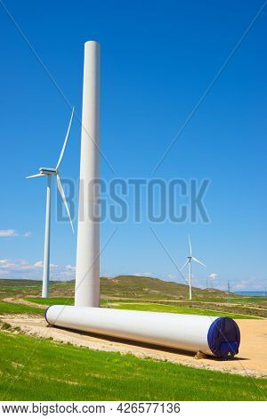 Construction of a windmill for the production of renewable energy.