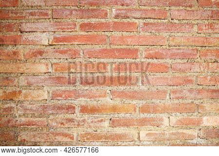 Front view of an old brick wall in Spain.