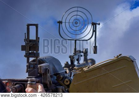 Fragment Of An Anti Aircraft Machine Gun, A Round Sight Is Aimed At Clouds Sky