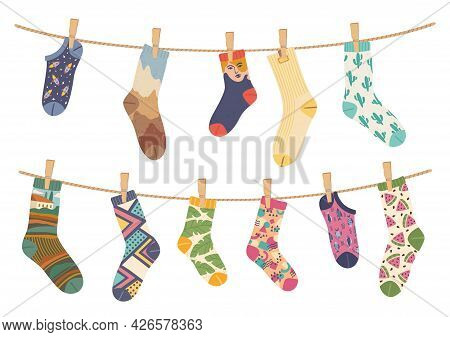 Socks On Rope. Cotton Sock With Cute Pattern Hanging And Drying On Laundry Ropes. Various Funny Sock