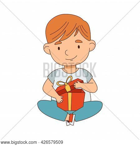 Redhead Little Boy Sitting With Gift Box As Holiday Present Vector Illustration