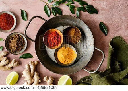 Curry spice ingredients butter chicken on a tray food photography flat lay