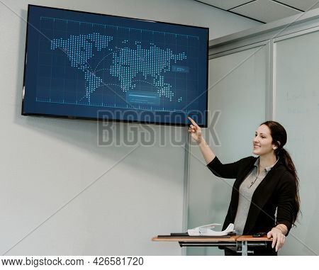 Lecturer using a TV screen in the classroom