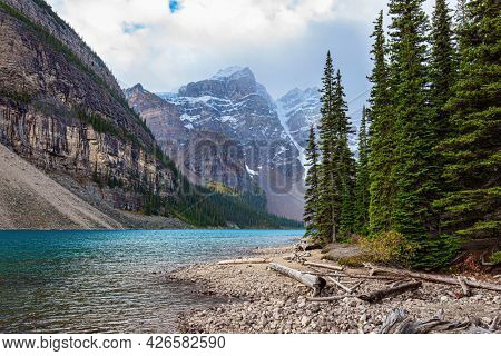 Magnificent mountain lake Moraine. Canadian Rockies. Banff Park. The glacial lake is fed by glacier melt water and is located in the Valley of the Ten Peaks