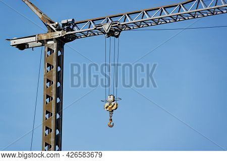 Gray Construction Crane With Big Pick To Lift And Move Elements In Front Of Blue Sky, Construction S